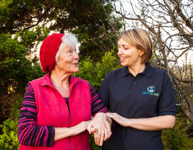 Client and Carer outside having a walk