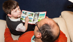 Client and grandson reading
