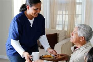 Nurse providing care at home